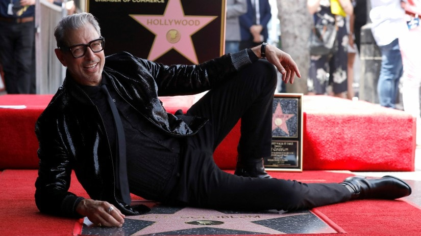 Actor Jeff Goldblum poses on his star after it was unveiled on the Hollywood Walk of Fame in Los Angeles. Reuters/Mario Anzuoni
