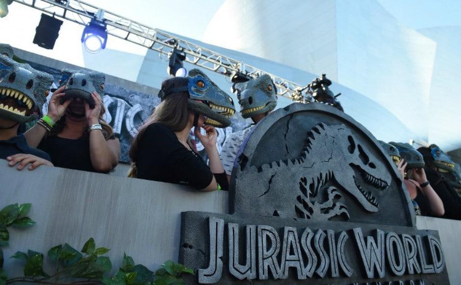 Fans wear dinosaurs masks waiting for the premiere of <em>Jurassic World: Fallen Kingdom</em>at The Walt Disney Concert Hall in Los Angeles, California on 12 June, 2018. AFP/ Robyn Beck