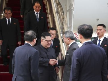 North Korean leader Kim Jong-un is greeted by Singapore Minister for Foreign Affairs Dr. Vivian Balakrishnan at the Changi International Airport on Sunday. AP