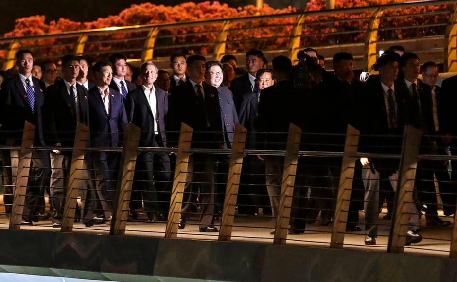 Kim emerged in his trademark Mao-style suit to walk out to his black limousine, accompanied by his sister, Kim Yo-jong, and aides. AP