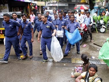 Civic workers inspect shops following the plastic ban in Maharashtra. PTI