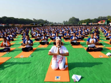 Narendra Modi practising yoga in Dehradun on Thursday. Twitter@PIB