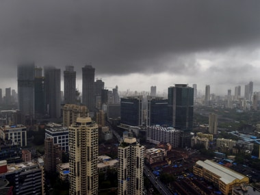 Dark evening clouds gather over the city skyline in Mumbai on Thursday. PTI