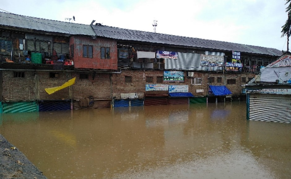 Shops in Anantnag town are seen submerged due to continuous rainfall in south Kashmir. Image: Sameer Mushtaq