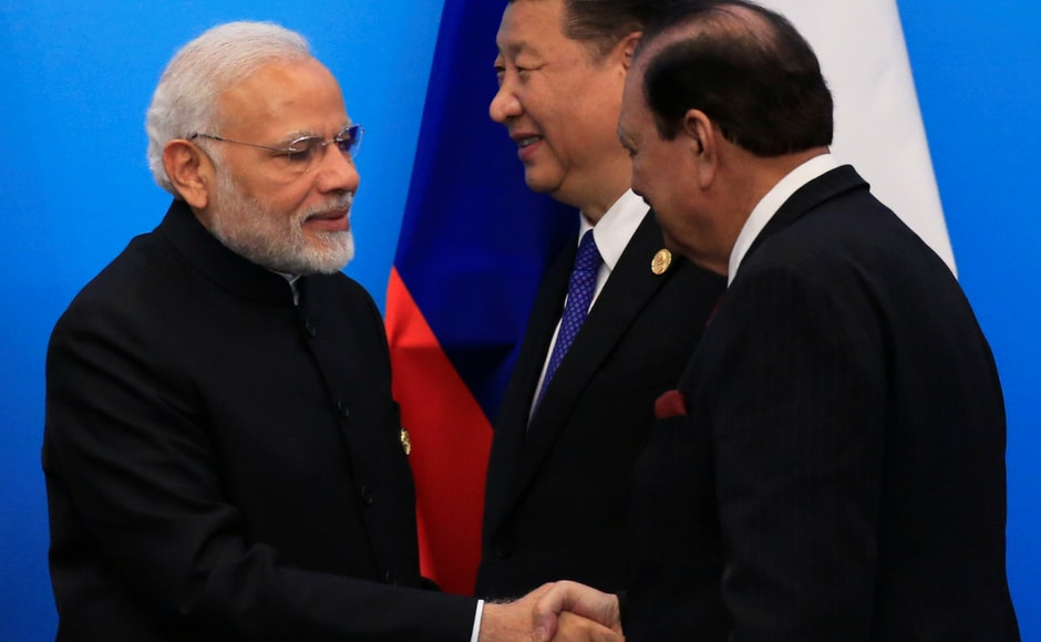 Modi and Pakistan's president Mamnoon Hussain exchanged pleasantries after a press conference by the leaders of the SCO. Modi and Hussain attended the summit for the first time after both countries were were admitted as members of the SCO in 2017. Reuters