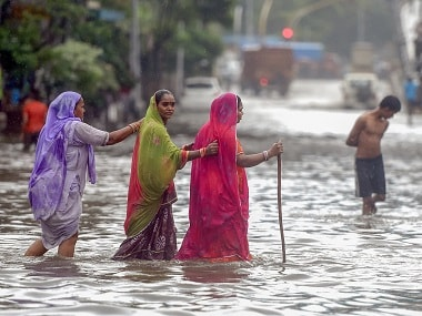 Heavy rains lash Mumbai as monsoon hits Maharashtra coast: Two people killed; flights, trains and road traffic hit