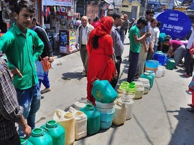 Monsoon. People stand in a queue to collect water from a tanker, as Shimla faces acute shortage of drinking water. PTI