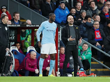 File image of Manchester City's Yaya Toure and manager Pep Guardiola. Reuters