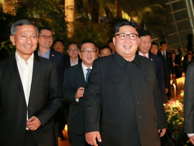 North Korea's leader Kim Jong-un, accompanied by Singapore's Foreign Minister Vivian Balakrishnan. Reuters via KCNA