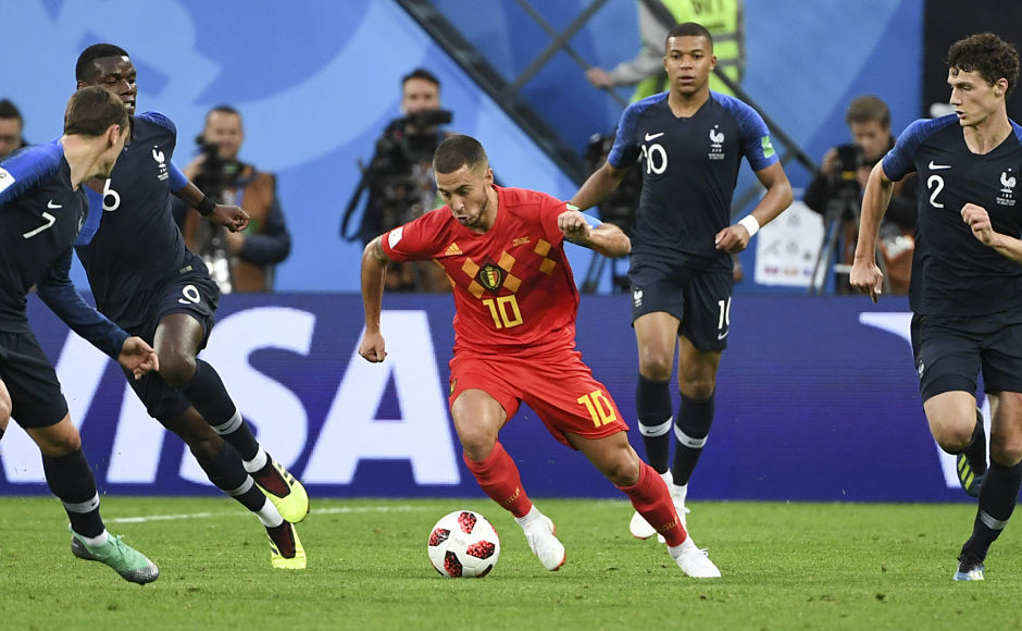 Belgium's star forward Eden Hazard tried to dribble past France defenders searching for an equaliser. AFP