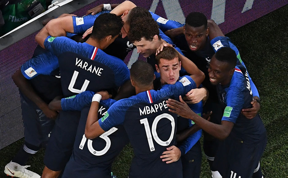 Samuel Umtiti celebrates with teammates after deflecting a thumping header for goal. AFP