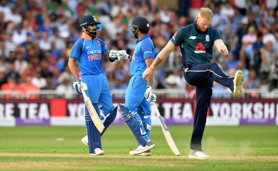 Ben Stokesexpressed his frustration asVirat Kohli (L) and Rohit Sharma (C) joined forces for a match-winning partnership of 167. AFP