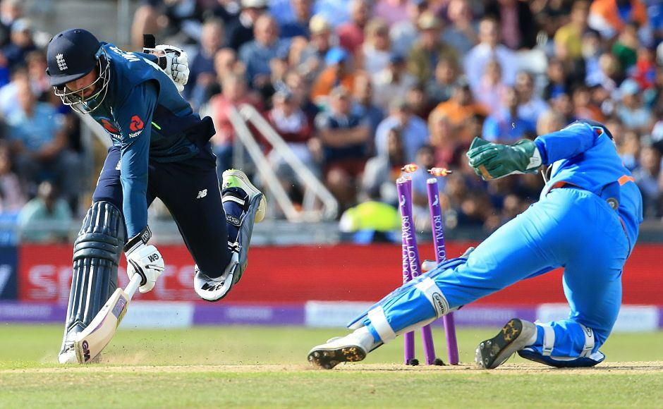 MS Dhoni took a stunning low throw from Hardik Pandya and disturbed the stumps to run James Vince out. AFP
