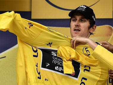 Great Britain's Geraint Thomas puts the overall leader's yellow jersey on the podium after the 20th stage of the 105th edition of the Tour de France. AFP