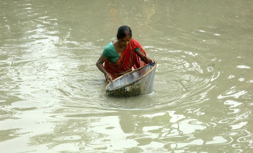 A woman fishing in waist deep water in a farm pond in Ranchi. Image courtesy Debjani Chakraborty