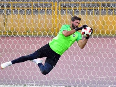Brazil's goalkeeper Alisson attends a training session ahead of their World Cup quarter-final against Belgium. AFP
