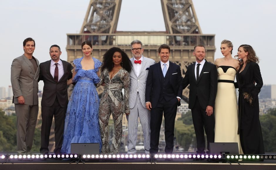 (From L-R) Henry Cavill, Jake Myers, Michelle Monaghan, Angela Bassett, director Christopher McQuarrie, Tom Cruise, Simon Pegg, Vanessa Kirby and Rebecca Ferguson pose for photographers upon arrival at the world premiere of Mission Impossible: Fallout in Paris. AP Photo/Thibault Camus