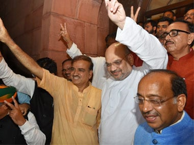 BJP president Amit Shah with party leaders Ananth Kumar, Vijay Goel and others showing victory signs after Centre won No-Confidence Vote in Parliament. PTI