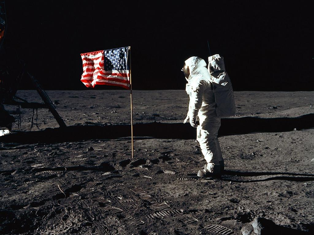 Astronaut Edwin E. Aldrin Jr., lunar module pilot of the first lunar landing mission, poses for a photograph beside the deployed US flag. Image: NASA
