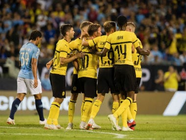 Borussia Dortmund players celebrate after scoring a goal. Twitter: @BVB