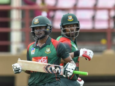 Shakib Al Hasan (L) and Tamim Iqbal (R) of Bangladesh 100 partnership react during the 1st ODI match between West Indies and Bangladesh at Guyana National Stadium. AFP