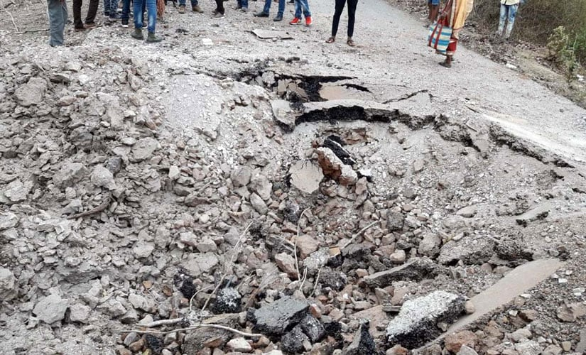 A large crater caused due to IED blast triggered by Maoists on Bijapur-Bhopalapattnam blacktop road. Photo procured by Firstpost/Debobrat Ghose