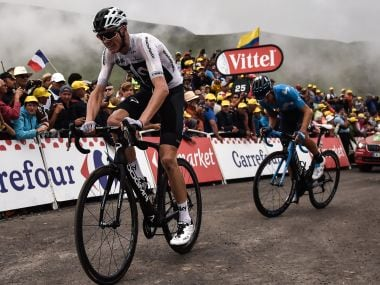 Chris Froome (left) and Mikel Landa ride in the last kilometer of the 17th stage. AFP