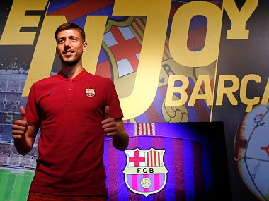 French player Clement Lenglet poses for media in a FC Barcelona's shop next to Camp Nou stadium in Barcelona. AP