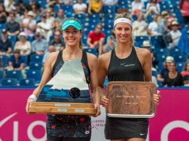 Winner Alize Cornet and runner-up Mandy Minella pose with their trophies. Image courtesy: Twitter WTA_Gstaad
