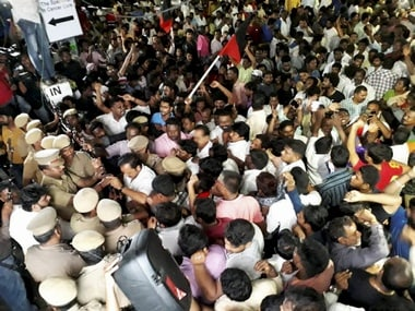 DMK supporters wait outside a private hospital M Karunanidhi has been admitted. PTI