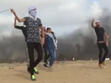 Palestinian great dance of return: Protesters take to music and dance even as Israeli forces continue to fire