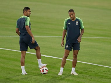 Brazil's Danilo and Casemiro wait for the start of the official training session of the Brazil team prior to the quarter final match against Belgium. AP