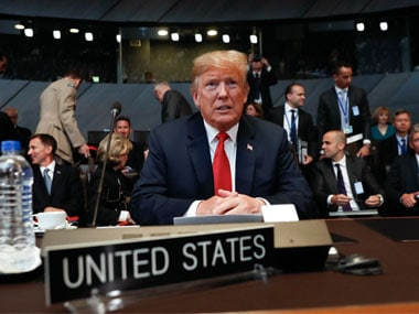 U.S. President Donald Trump takes his seat as he attends the multilateral meeting of the North Atlantic Council on Wednesday. AP