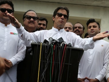 Imran Khan, chairman of PTI, speaking to the media after casting his vote. Reuters