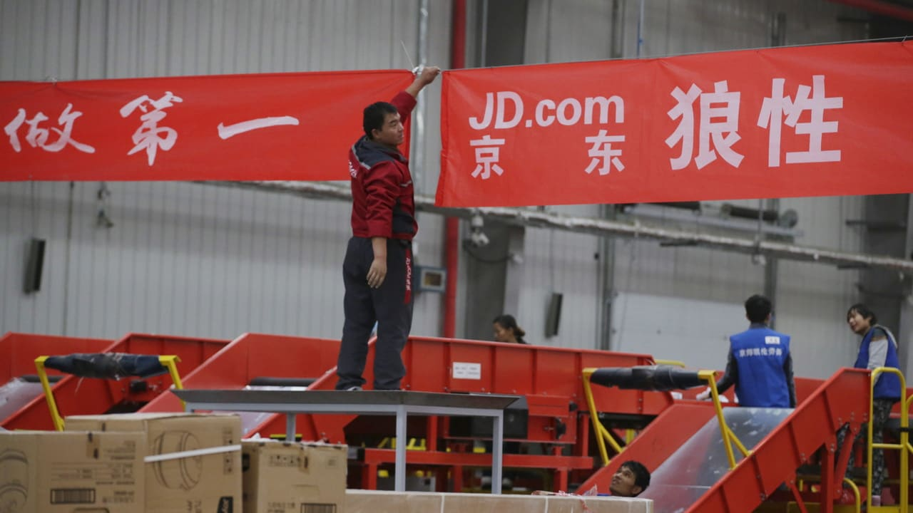 An employee works at a JD.com logistic centre in Langfang, Hebei province, November 10, 2015. On China's giant Singles Day internet shopping festival, the country's delivery firms are stretched so thin that they are looking for tie-ups, listings and new investors to husband their resources. E-commerce has been a huge boon to the logistics industry, but the ever-bigger Singles Day, run by leading online market company Alibaba Group Holding Ltd on Nov. 11 every year, exacerbates the industry's twin dilemmas of cut-throat competition and rising labor costs. With low barriers to entry, express couriers proliferated rapidly over the past decade to more than 8,000 firms, squeezing profit margins to about 5 percent, down from 30 percent 10 years ago, according to analysts. To match CHINA-SINGLES DAY/LOGISTICS REUTERS/Jason Lee - GF20000053038