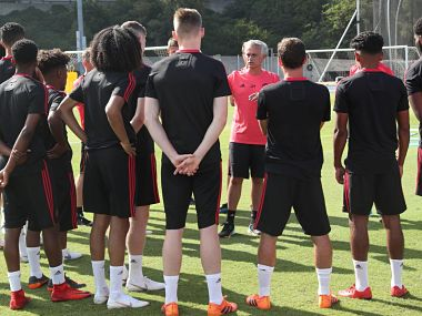 Jose Mourinho speaks to players at Manchester United's pre-season camp. Image courtesy: Twitter @ManUtd
