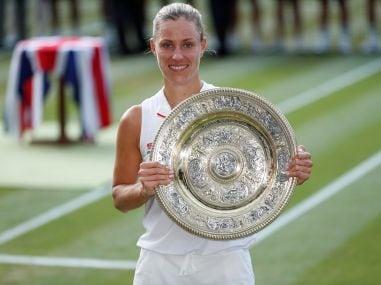 Angelique Kerber celebrates winning the Wimbledon women's singles final with the trophy, Reuters