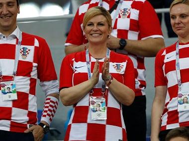 Croatia's President Kolinda Grabar-Kitarovic, applauds the national team during the FIFA World Cup 2018. AP