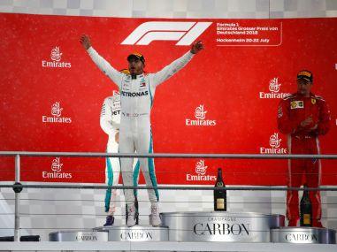 German Grand Prix: Mercedes' Lewis Hamilton wins chaotic, wet race as Sebastian Vettel's mistake costs him dear