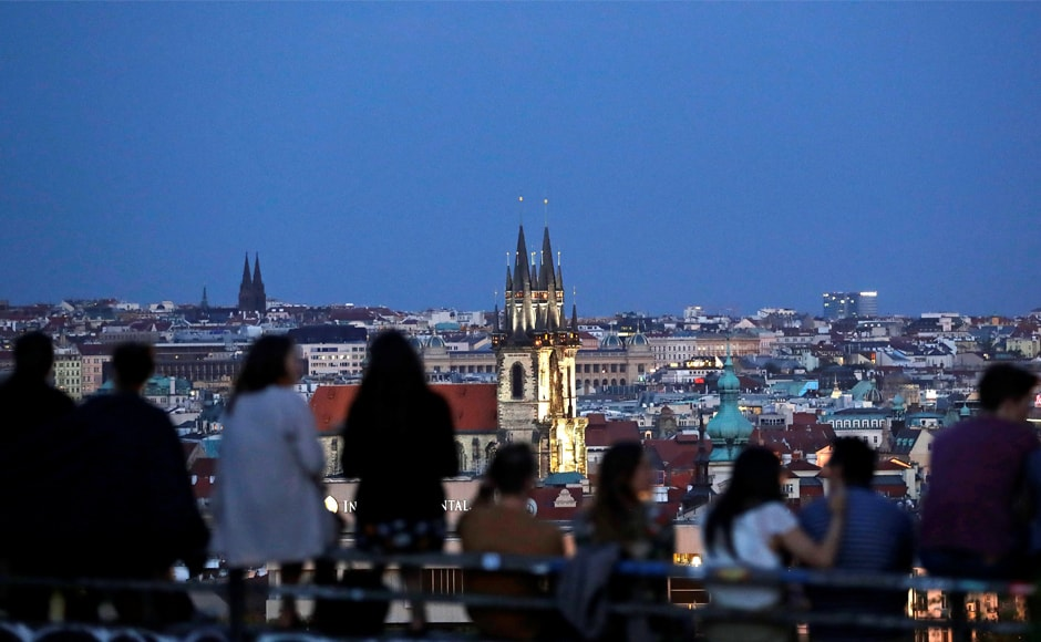 Clouds obscure the view for people waiting to see the lunar eclipse in Prague, Czech Republic. Bad weather thwarted the cosmic display in several parts of the world. Reuters