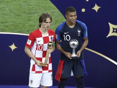 Croatia's Luka Modric and France's Kylian Mbappe pose with their respective awards in the 2018 World Cup final. AP