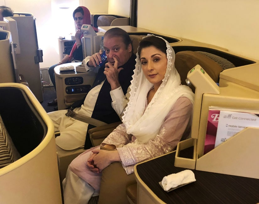 Ousted Pakistani Prime Minister Nawaz Sharif and his daughter Maryam sit on a Lahore-bound flight due for departure, at Abu Dhabi International Airport. Reuters