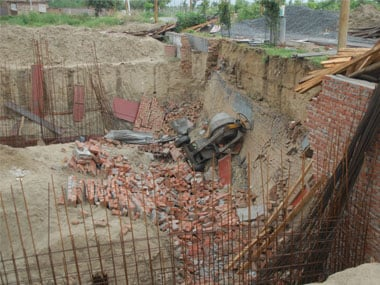 A labourer and a four-year-old child have died after an under construction wall collapsed in Noida. PTI