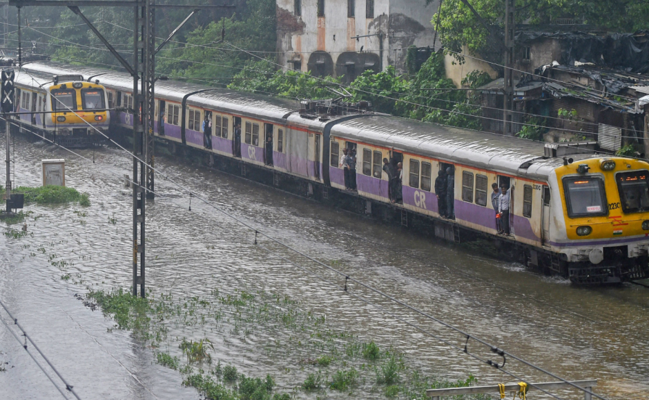 Local trains, considered the lifeline of Mumbai, on Tuesday moved at the snail's pace due to water-logging of the tracks, resulting in harrowing times for<br />lakhs of office-goers and other commuters. PTI