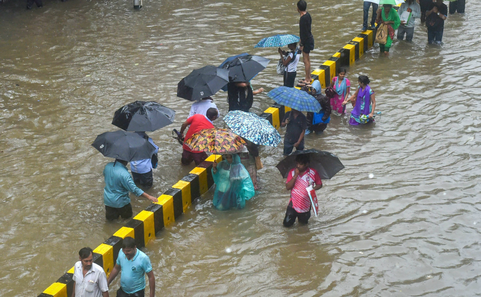 The downpour flooded many roads and streets in low-lying areas of the city and its adjoining districts of Palghar and Thane. People at some places were seen wading through waist-deep water. PTI