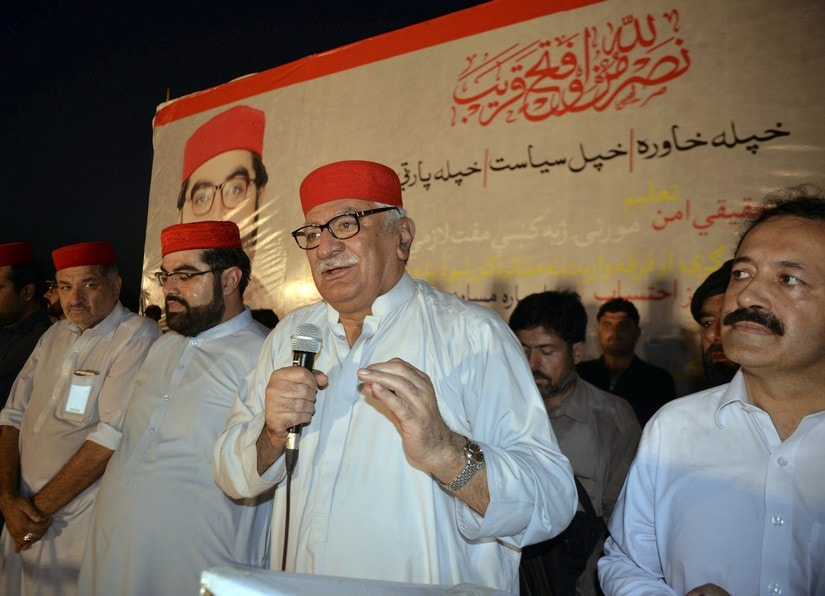 Asfandyar Wali Khan, center, head of Awami National Party addresses to his supporters during an election campaign. AP