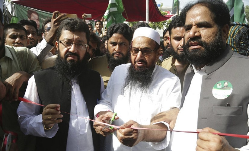 Jamaat-ud-Dawa chief Mohamad Hafiz Saeed inaugurates an election office of the newly formed political party Allah-o-Akbar Tehreek in Lahore, Pakistan. AP