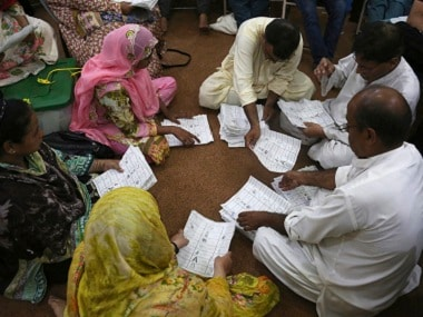 Pakistani election staff count the votes polled. AP