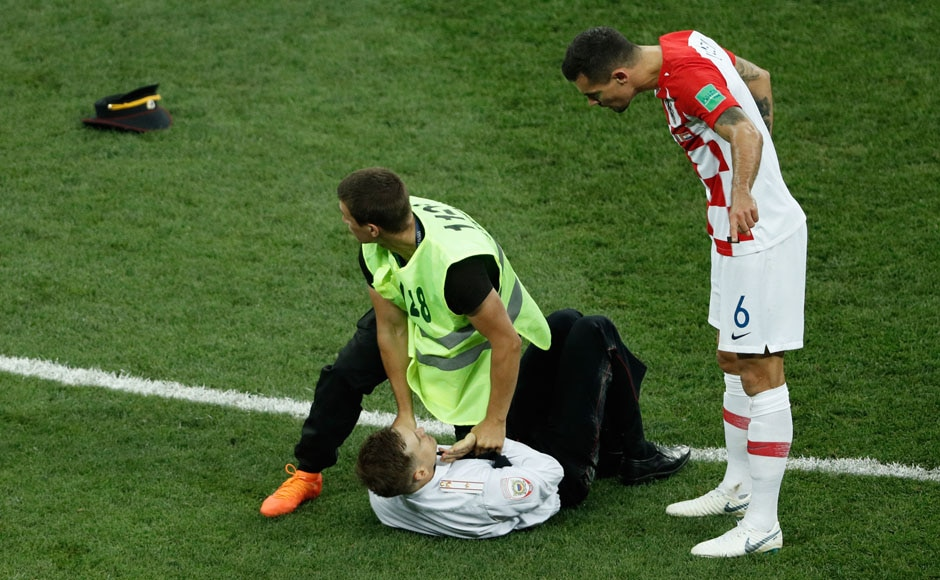 Croatia turned it up a notch after conceding for the second time, but their momentum was disrupted when a group of individuals invaded the pitch and lead the stewards on a walkabout. AFP