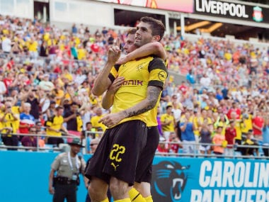 Borussia Dortmund's Christian Pulisic scores his second goal against Liverpool. Twitter: @BVB